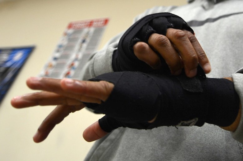U.S. Air Force Tech. Sgt. Andre Penn, 20th Civil Engineer Squadron unaccompanied housing manager, wraps his hands prior to training at Team Robinson Mixed Martial Arts in Sumter, South Carolina, Nov. 7, 2017.