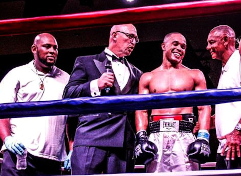 "U.S. Air Force Tech. Sgt. Andre Penn, 20th Civil Engineer Squadron unaccompanied housing manager, center right, is congratulated following his boxing match win at the ""Battle in the Panhandle,"" in Fort Walton Beach, Florida, Nov. 18, 2017."