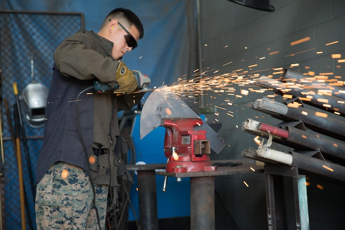A U.S. Marine with 1st Light Armored Reconnaissance Battalion, 1st Marine Division, uses a grinder to repair a part for a High Mobility Multi-Purpose Wheeled Vehicle aboard Camp Pendleton, Calif., Dec. 4, 2017. The Marines are conducting routine maintenance in preparations for 1st Marine Division-led Exercise Steel Knight 2018.