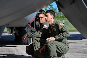 Air Force 2nd Lt. Isaias Rivera and Air Force Lt. Col. Evaristo Orengo, the 198th Airlift Squadron commander, conduct a pre-flight inspection before Rivera's first home base flight at Muniz Air National Guard Base, Puerto Rico, Nov. 22, 2017. Puerto Rico Air National Guard photo by Air Force Capt. Matt Murphy