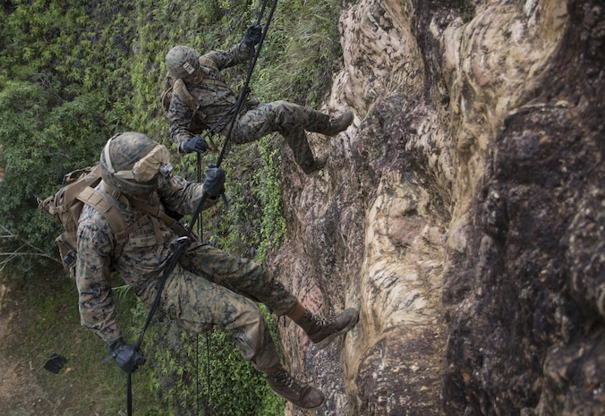 U.S. Marines rappel during the rappel phase of the 3rd Marine Division Annual Squad Competition December 4, 2017, in Okinawa, Japan. The squad competition is a challenge to see which unit is the fittest for combat. The four units participating in the competition are deployed to Okinawa, Japan, under the Unit Deployment Program. The units are 1st Battalion, 8th Marines; 2nd Battalion, 1st Marines; 1st Battalion, 3rd Marines and Combat Assault Battalion.