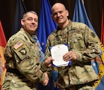 Army Staff Sgt. William Fernandez is recognized as DLA's Non-Commissioned Officer of the Quarter, fourth quarter, fiscal year 2017 by DLA Distribution commander Army Brig. Gen. John S. Laskodi.