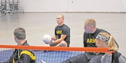 Staff Sgt. Shawn Runnells, WTB Soldier, center holding the volleyball, participated in the game. The sport event was held at the WTB Gym Bldg. 675 for Warrior Care Month on Nov. 15. The WTB Soldiers played together in a team spirit way for physical and emotional recovery to transition or return to duty.