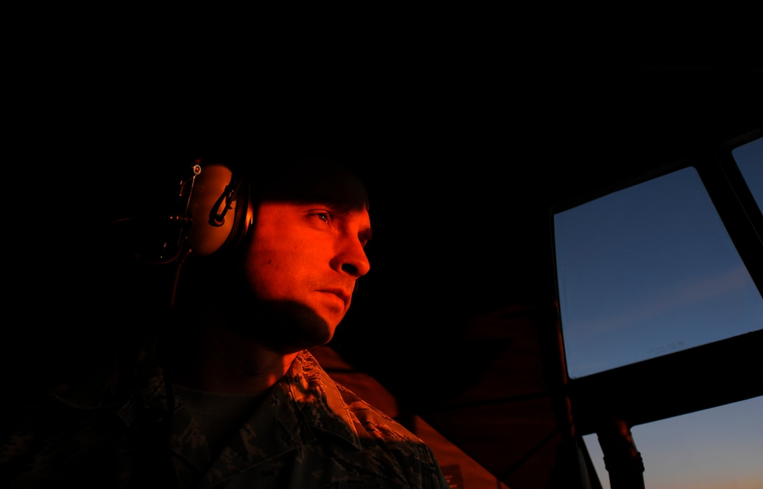 U.S. Air Force Master Sgt. Caleb Thorne, 86th Aircraft Maintenance Squadron productions superintendent, watches the sunrise over Shannon, Ireland, from a C-130J Super Hercules Dec. 4, 2017. The crew traveled across three countries and three states within the U.S. in one week to pick-up Ramstein's new aircraft from Lockheed Martin Aeronautics Company production facility headquarters in Marietta, Georgia. (U.S. Air Force photo by Airman 1st Class Savannah L. Waters)