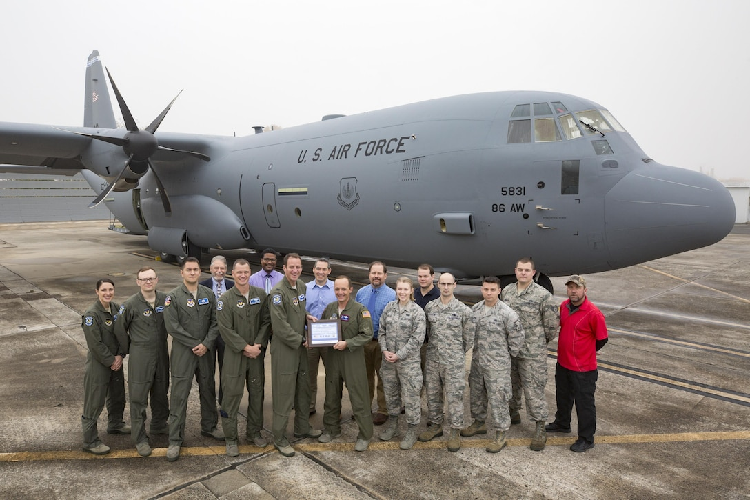 "Lockheed Martin Aeronautics Company turns over the keys to the newest C130J in the 37th Airlift Squadron fleet to the team from Ramstein. Part of a concept, according to Air Mobility Command, called ""Enterprise Fleet Management"", the new aircraft replaces a C-130J that was transferred to Yokota Air Base. (Courtesy photo, Lockheed Martin Aeronautics Company)"