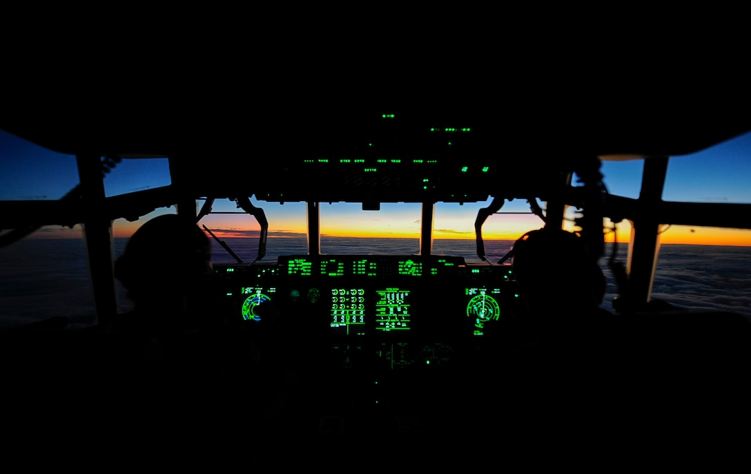 U.S. Air Force 1st Lt. Melinda Marlow (left), and Maj. Kyle Bucher (right), 37th Airlift Squadron C-130J Super Hercules pilots, fly a C-130J over Shannon, Ireland, during the sunrise Dec. 4, 2017. A crew assigned to the 37th Airlift Squadron crossed the Atlantic Ocean to retrieve a brand new C-130J Super Hercules from the Lockheed Martin Aeronautics Company production facility, in Marietta, Georgia, Nov. 29. (U.S. Air Force photo by Airman 1st Class Savannah L. Waters)