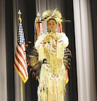 Dennis Lee Rogers, a tribal member of the Navajo Nation and dancer dressed in full eagle feather regalia, performs during the Native American Indian History observance Nov. 15 at Barlow Theater.