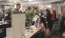 Soldiers talk with advisers and representatives from colleges around Fort Riley about meeting their education goals Nov. 16 during the annual Hiring and Education Career Fair at Riley's Conference Center. More than 140 employers and higher education institutions were in attendance to meet with service members, retirees, their families and members of the surrounding communities.