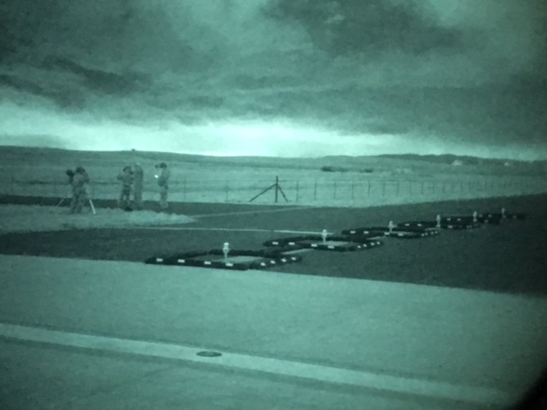 Airmen from the 60th Aerial Port Squadron set up night vision equipment during a recent training event at Travis Air Force Base, Calif. The 60th APS is in the process of transitioning the currently used green phosphor night vision goggles to white and black phosphor NVGs. White and black phosphor NVGs offer modern day technology and enhance mission effectiveness when operating in low-light or no-light conditions.