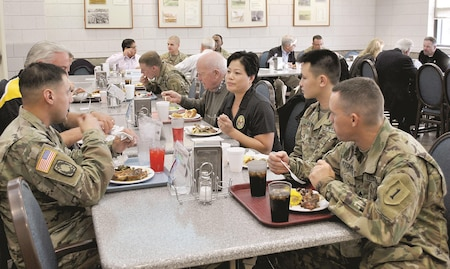 Civilian Aides to the Secretary of the Army dine with Soldiers from their respective states at Devil's Den dining facility Nov. 15. The CASAs toured Fort Riley to learn more about the infrastructure and training available to Soldiers at the installation. Dining with the Soldiers provided them a chance to learn more about them and what it's like to be in the Army.