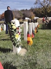 German and Italian flags rest near the graves of World War II prisoners of war who passed away at the installation at the Fort Riley Main Post Cemetery during the annual German and Italian Memorial Ceremony Nov. 16.