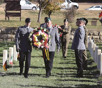International officers stationed at Fort Leavenworth, Kansas, lay a wreath for the annual German and Italian Memorial Ceremony Nov. 16 to remember prisoners of war buried in the Fort Riley Main Post Cemetery.