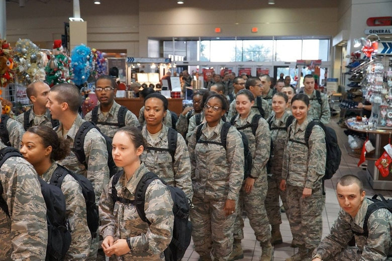 Air Force basic trainees from Joint Base San Antonio-Lackland wait to be admitted to the JBSA-Lackland Base Exchange Dec. 2 to do some early shopping. About 3,800 trainees were treated to holiday cheer Dec. 2 at the Lackland Exchange, which opened extra early just for them. Typically, trainees are not allowed to visit the Exchange or do much beyond their rigorous assignments.