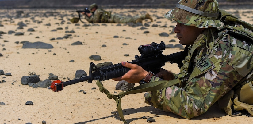 Soldiers assigned to Combined Joint Task Force Horn of Africa keep watch as their platoon sets up an objective rally point on the first day of a French Desert Commando Course at the Djibouti Range Complex near Arta, Djibouti.