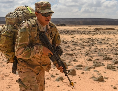 Army Sgt. Gabriel Mancera, with the Texas Army National Guard's 3rd Battalion, 144th Infantry Regiment, Task Force Bayonet, moves to a defensive position during the first day of a French Desert Commando Course at the Djibouti Range Complex near Arta, Djibouti.