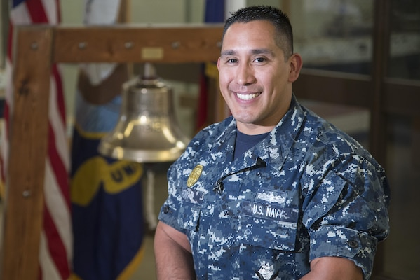 Petty Officer First Class Christopher Thomas, Navy Recruiting District San Antonio recruiter, poses for a portrait Oct. 25, 2017.  Thomas' mission is to find officer applicants to lead naval forces in conducting operations on land, air and sea.  (U.S. Air Force photo by Sean M. Worrell)