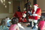 Santa reads to kids