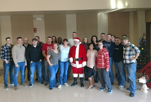 Members of the 391st MP Battalion with Santa