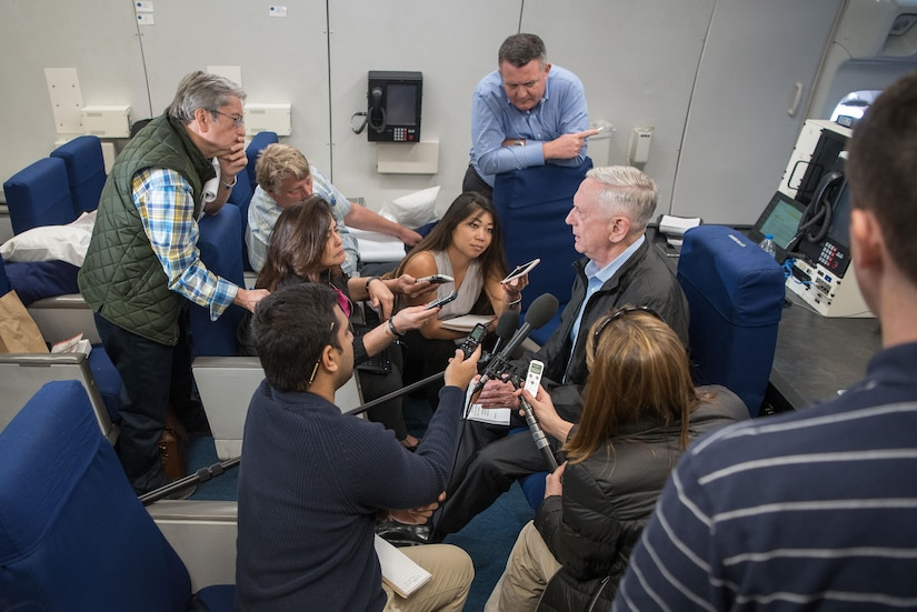 Defense Secretary James N. Mattis speaks with the media during a flight to Kuwait from Aqaba, Joran, Dec. 3, 2017. (DoD photo by Army Sgt. Amber I. Smith)