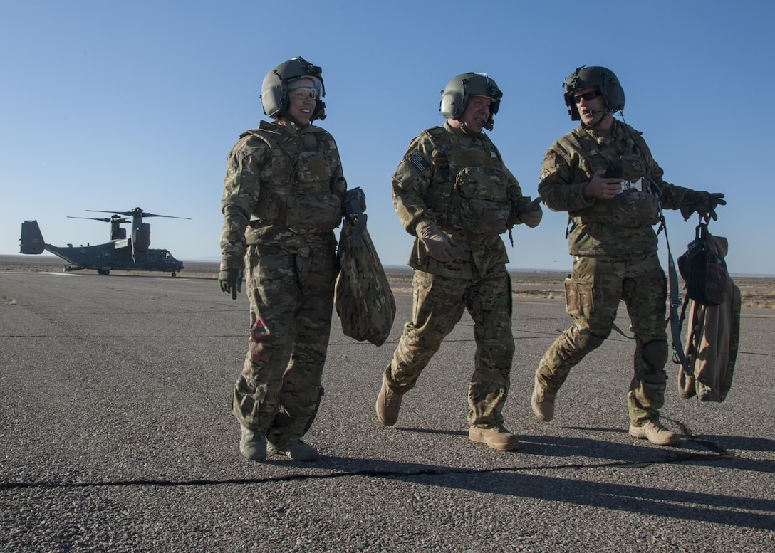 U.S. Air Force Chief Master Sgt. Juliet Gudgel, command chief master sergeant of Air Education and Training Command, is escorted from one training sortie to another at Kirtland Air Force Base, N.M., Nov. 27, 2017. This was Gudgel's first visit to Kirtland as AETC command chief. (U.S. Air Force photo by Staff Sgt. J.D. Strong II)