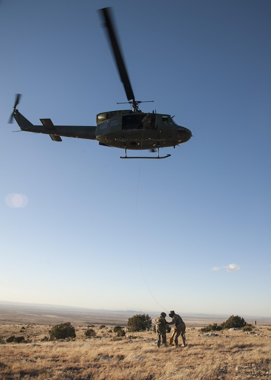 U.S. Air Force Chief Master Sgt. Juliet Gudgel, command chief master sergeant of Air Education and Training Command, is lifted into a UH-1H Huey during a rescue training scenario at Kirtland Air Force Base, N.M., Nov. 27, 2017. Gudgel visited the installation for two days to speak with the Airmen and gain a better understanding of what they do to support the 58th SOW, AETC and Air Force Special Operations Command. (U.S. Air Force photo by Staff Sgt. J.D. Strong II)