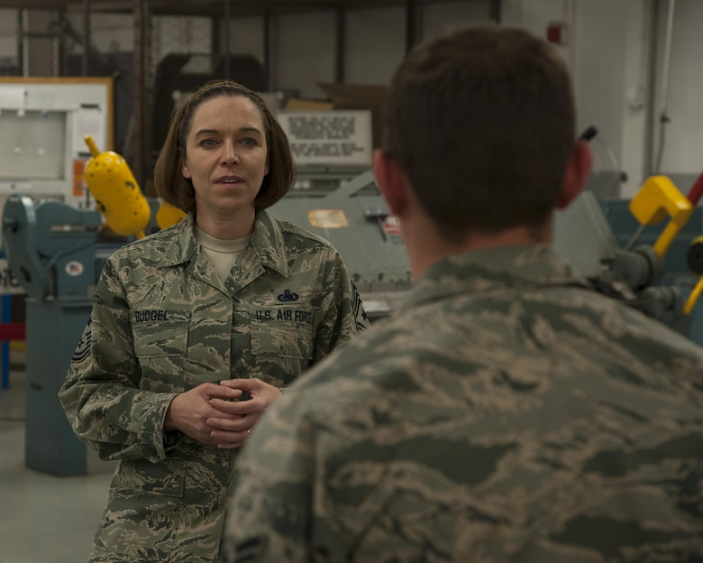 U.S. Air Force Chief Master Sgt. Juliet Gudgel, command chief master sergeant of Air Education and Training Command, laughs while speaking with Airmen from the 58th Special Operations Wing, at Kirtland Air Force Base, N.M., Nov. 27, 2017. Gudgel visited the installation for two days to speak with the Airmen and gain a better understanding of what they do to support the 58th SOW, AETC and Air Force Special Operations Command. (U.S. Air Force photo by Staff Sgt. J.D. Strong II)