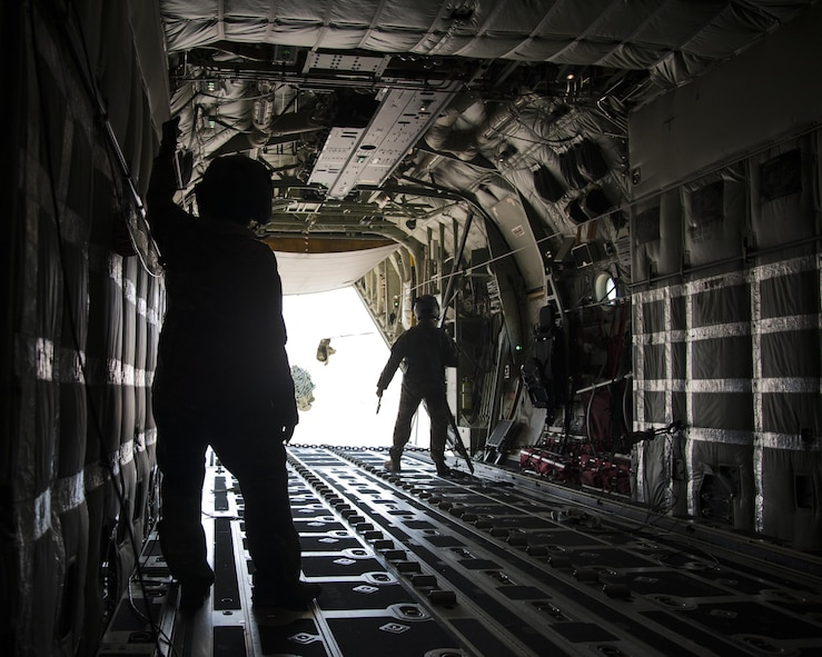U.S. Air Force Chief Master Sgt. Juliet Gudgel, Air Education and Training Command command chief watches a cargo drop training mission at Kirtland Air Force Base, N.M., Nov. 28, 2017. On her second day of the visit Gudgel, was able to participate in four training missions with the Airmen of the 58th SOW. (U.S. Air Force photo by Staff Sgt. J.D. Strong II)