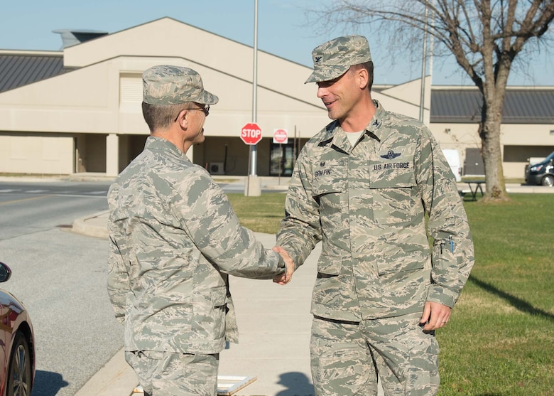 Brig. Gen. Steven Bleymaier, Director of Logistics, Engineering and Force Protection, Headquarters Air Mobility Command, is greeted by Col. Ethan Griffin, commander of the 436th Airlift Wing, upon arrival Nov. 29, 2017, at Dover Air Force Base, Del.
