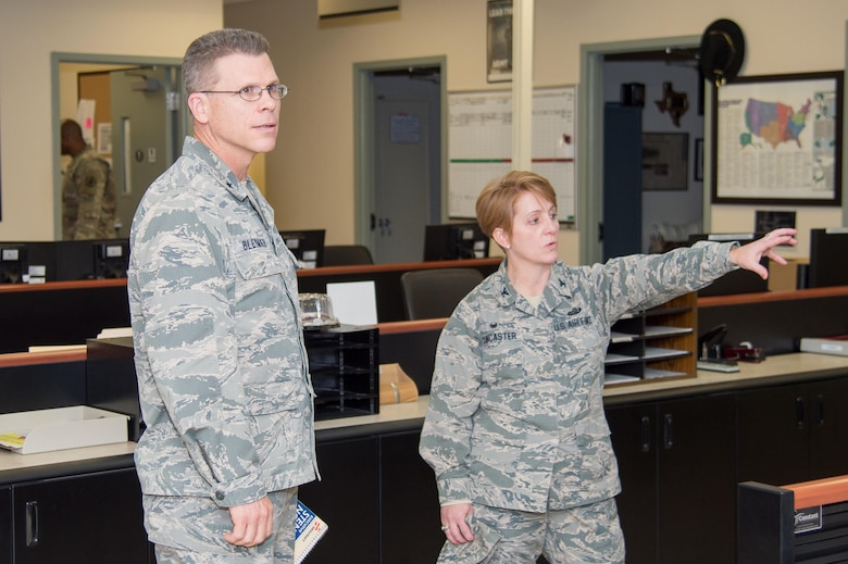 Col. Dawn Lancaster, Air Force Mortuary Affairs Operations commander, gives Brig. Gen. Steven Bleymaier, Director of Logistics, Engineering and Force Protection, Headquarters Air Mobility Command, a tour of the AFMAO command center Nov. 29, 2017, at Dover Air Force Base, Del.