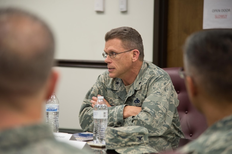 Brig. Gen. Steven Bleymaier, Director of Logistics, Engineering and Force Protection, Headquarters Air Mobility Command, takes questions from unit commanders during a tour Nov. 29, 2017, at Dover Air Force Base, Del.