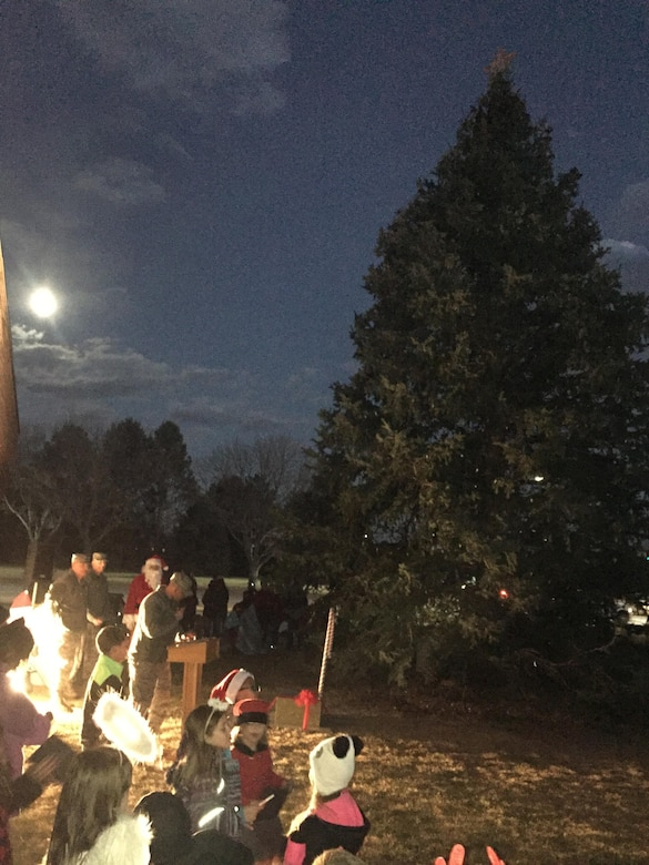PETERSON AIR FORCE BASE, Colo. — The supermoon peaks out from behind the Chapel to help light up the holiday tree on Peterson Air Force Base, Colorado, Dec. 1, 2017. Airmen and their families came out to have cocoa and cookies, meet Santa and watch the tree lighting at the Chapel. (U.S. Air Force photo by Alethea Smock)