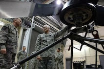 Maj. Gen. Craig La Fave, 22nd Air Force commander, examines a prop during a tour at Dobbins Air Reserve Base, Georgia Dec. 2, 2017. La Fave visited various facilities and met squadron leaders during the tour. (U.S. Air Force photo by Staff Sgt. Miles Wilson)