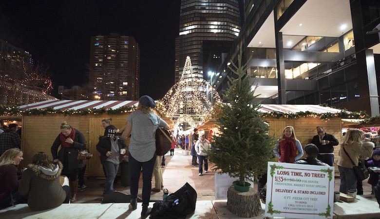 DENVER, Colo. – A musician plays holiday music for a crowd of people visiting the Christkindl Market in Denver, Colorado Dec. 1 2017. The market sells a large variety of holiday-related goods, such as Christmas trees, Christmas decorations, and holiday food and drink. (U.S. Air Force photo by 2nd Lt. Justin Davidson-Beebe)