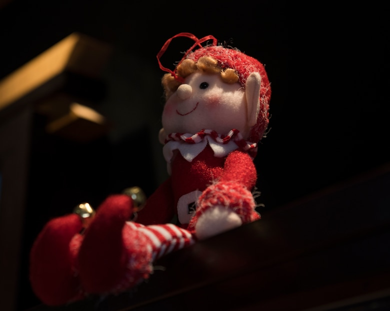 PETERSON AIR FORCE BASE, Colo. -- A little Elf waits patiently to welcome guests into the Chapel on Peterson Air Force Base, Colorado, Dec. 4, 2017. The Chapel's take on the popular holiday adornment tradition adds a touch of playfulness to the holiday decorations. (U.S. Air Force photo by Airman First Class Alexis Christian)