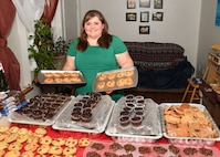 Nicole Lindgren, a member of the Spouses Club on base, baked nearly 500 cookies for the annual cookie drive on Grand Forks Air Force Base, N.D., Dec. 1, 2017. In addition to baking almost 500 cookies, Lindgren reached out to the community and received over 150-dozen more donations of muffins, popcorn balls and other assorted cookies. (U.S. Air Force photo by Airman 1st Class Elora J. Martinez)