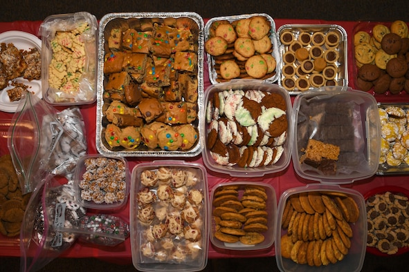 The Spouses Club on base held the annual cookie drive Dec. 4, 2017, on Grand Forks Air Force Base, N.D. Volunteers teamed up to bake, plate and deliver nearly 3,000 treats to the Airmen in the dorms and squadrons on base. (U.S. Air Force photo by Airman 1st Class Elora J. Martinez)