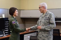 Maj. Gen. Craig La Fave, 22nd Air Force commander, coins Staff Sgt. Kea Hartley, 94th Aeromedical Evacuation Squadron medical technician, at Dobbins Air Reserve Base, Georgia Dec. 2, 2017. Hartley was recognized for her work backfilling as commander support for six months. (U.S. Air Force photo by Staff Sgt. Miles Wilson)