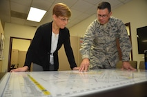 Mrs. Jill La Fave, spouse of Maj. Gen. Craig La Fave, 22nd Air Force commander, looks at a base map with Col. Marty Hughes, 94th Mission Support Group commander, at Dobbins Air Reserve Base, Georgia Dec. 2, 2017. The La Faves and Chief Master Sgt. Clinton Ronan, 22nd AF command chief, visited Reserve Citizen Airmen at the 94th Airlift Wing here during the December drill weekend. (U.S. Air Force photo by Senior Airman Lauren Douglas)