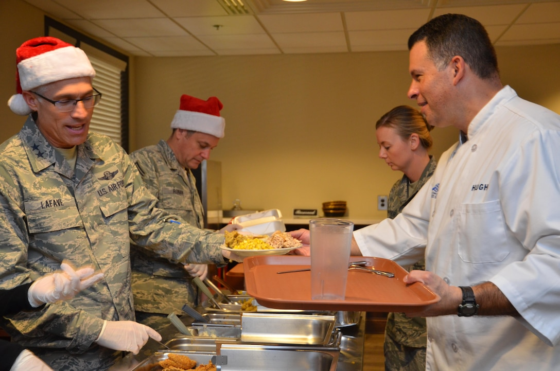 Maj. Gen. Craig La Fave, 22nd Air Force commander, serves holiday meals to Airmen during lunch at Dobbins Air Reserve Base, Georgia Dec. 2, 2017. Afterward, the general sat down for a holiday meal with a group of Airmen. (U.S. Air Force photo by Senior Airman Lauren Douglas)