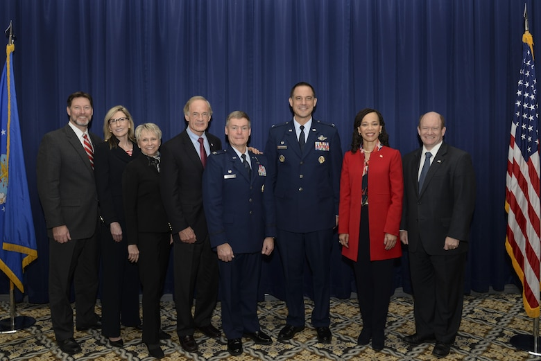 Col. Craig Peters, 512th Airlift Wing commander, and Col. Ethan Griffin, 436th AW commander, stand with Delaware politicians at the State of the Base Breakfast Nov. 20, 2017, at Dover Air Force Base, Del. Event speakers explained how both the base and Delmarva community benefit from the partnerships forged through teamwork. (U.S. Air Force photo by Staff Sgt. Aaron J. Jenne)