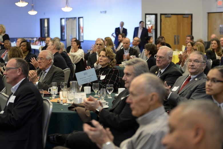 Team Dover community members applaud during the annual State of the Base Breakfast Nov. 20, 2017, at Dover Air Force Base, Del. Local community members, business leaders and government representatives attended the event to learn more about the installation and the Airmen of Dover AFB. (U.S. Air Force photo by Staff Sgt. Aaron J. Jenne)