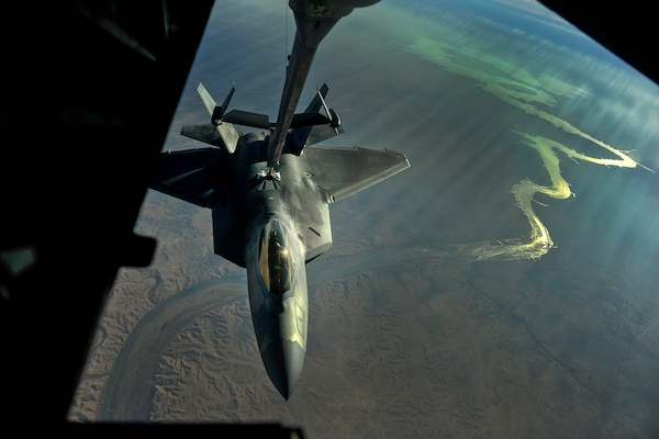 An F-22 Raptor aircraft receives fuel from a KC-10 over Iraq, Nov. 29, 2017. The F-22, assigned to the 380th Air Expeditionary Wing, is supporting Operation Inherent Resolve. Air Force photo by Tech. Sgt. Anthony Nelson Jr.