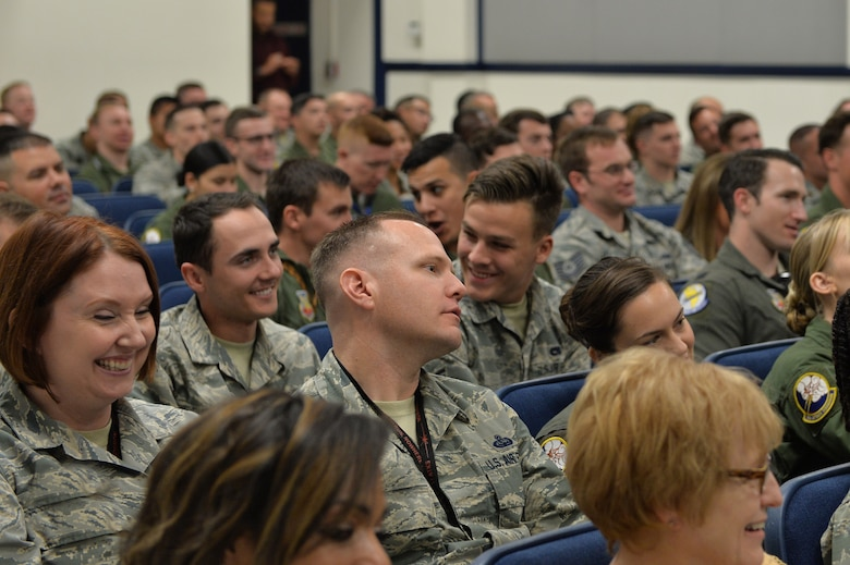 Audience members laugh as retired Lt. Col. Dave Grossman jokes about human interaction Nov. 13, 2017, at Creech Air Force Base, Nev. Grossman visited team Creech to discuss the psychological costs of military service with Airmen who are involved in combat operations on a daily basis. (U.S. Air Force Photo by Airman 1st Class Haley Stevens)