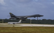 A U.S. Air Force B-1B Lancer, assigned to the 37th Expeditionary Bomb Squadron, deployed from Ellsworth Air Force Base (AFB), South Dakota, lands at Andersen AFB, Guam, Dec. 4, 2017.