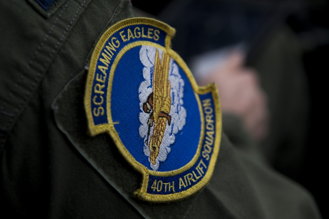 The Screaming Eagles 40th Airlift Squadron patch rests on the arm of Capt. Kyle Schneider, 40 AS C-130J Super Hercules pilot, Dec, 1, 2017, at Yokota Air Base, Japan.
