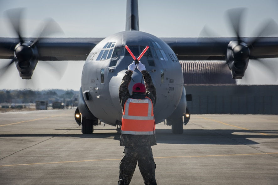 An Airman with the Republic of Korea Air Force signals to a U.S. Air Force C-130J Super Hercules where to stop in preparation for exercise Vigilant Ace 18, Dec. 1, 2017, at Gwangju Airbase, Republic of Korea.