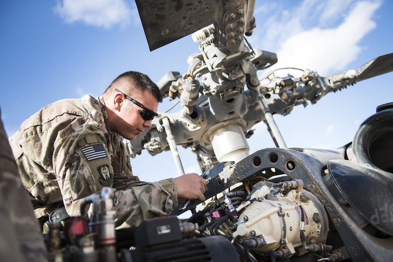 Staff Sgt. Robert Wainright, an HH-60G Pave Hawk crew chief assigned to the 801st Expeditionary Maintenance Squadron, works to replace a pair of hydraulic lines November 22, 2017, in an undisclosed location. Demanding desert conditions and in-flight vibrations inherent to helicopters are especially taxing on aircraft components, which require frequent inspections to ensure safe operation. (U.S. Air Force photo by Staff Sgt. Joshua Kleinholz)