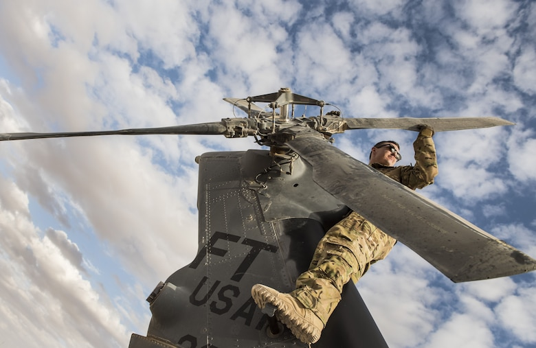 A special missions aviator assigned to 46th Expeditionary Rescue Squadron, inspects the blades on an HH-60G Pave Hawk helicopter tail rotor prior to a sortie November 22, 2017, in an undisclosed location. Rotor blades are subjected to massive amounts of force in-flight and require frequent inspections and repairs in order to ensure safe flight. (U.S. Air Force photo by Staff Sgt. Joshua Kleinholz)