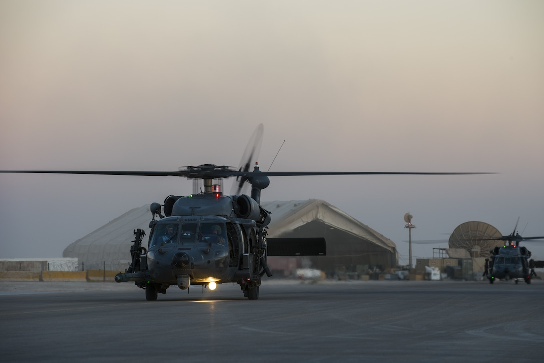 HH-60G Pave Hawk Helicopters assigned to the 46th Expeditionary Rescue Squadron, return to base following the completion of a sortie, October 24, 2017 in an undisclosed location. Rescue teams-comprised of pilots, special missions aviators, and pararescuemen - work together to maintain a constant state of readiness. (U.S. Air Force photo by Staff Sgt. Joshua Kleinholz)