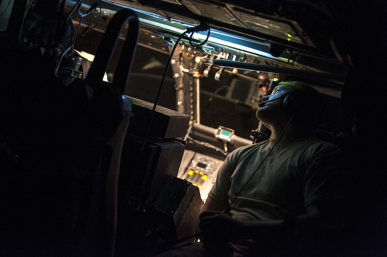 Senior Airman Jarrod Williams, an HH-60G Pave Hawk crew chief assigned to the 801st Expeditionary Maintenance Squadron, troubleshoots avionics systems November 21, 2017, in an undisclosed location. Maintenance Airmen work shifts around the clock to ensure rescue teams can rely on safe, mission-capable aircraft in the event of a call. (U.S. Air Force photo by Staff Sgt. Joshua Kleinholz)